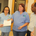 Helen Bouman, RN, speaks to store manager