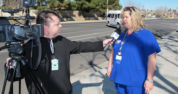 Michelle Swett speaks to Time Warner Cable in front of Kaiser Lancaster